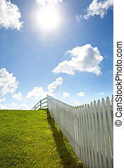 white fence, grass and sky