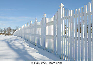 white fence in winter - white fence on the snow in winter