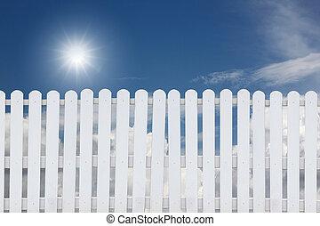 White fence on a blue sky.