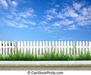 white fence with blue sky