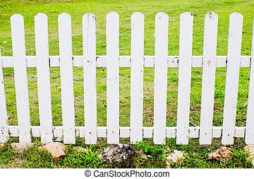 White fence with green grass