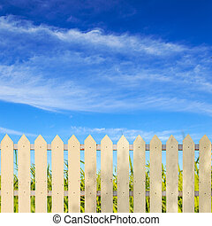 White fences with blue sky