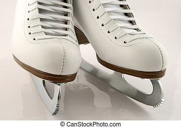 White figure skates - A pair of elegant white figure skates.
