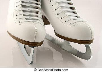 White figure skates - A pair of elegant white figure skates.
