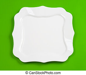 White figured plate on green background