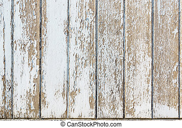 White flaky paint on a old weathered wooden fence. Vintage wood background.
