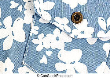 White flower pattern on blue fabric pocket.