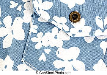 White flower pattern on blue fabric pocket.