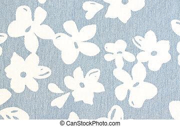 White flower pattern on blue fabric.