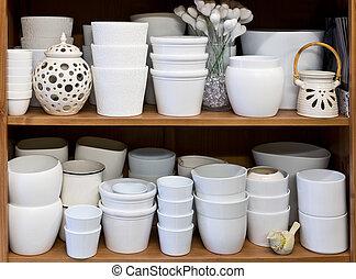 white flowerpots in the florist store