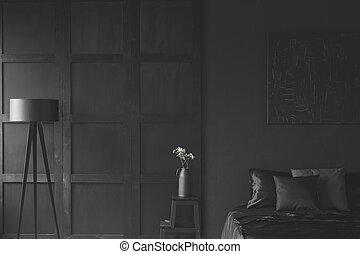 White flowers in black bedroom