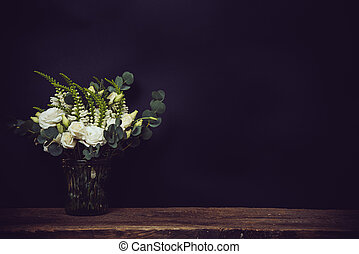 white flowers on an old wooden board with black chalkboard