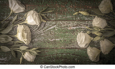 White flowers on the old wooden background top view