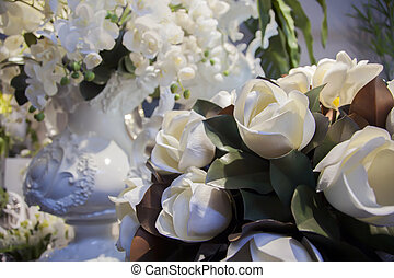 white flowers background and classic vase