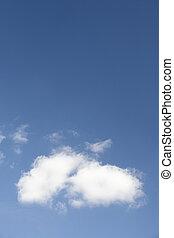 White Fluffy Cloud Against Blue Sky
