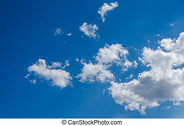 white fluffy clouds in blue sky