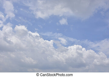 White Fluffy Clouds In The Blue Sky, For Background.