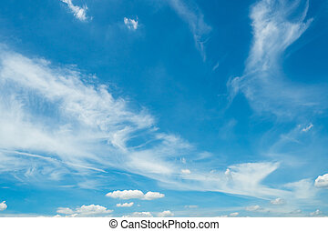 White fluffy clouds on blue sky. Soft touch feeling like cotton. White cloudscape with space for text. Beauty in nature. Close-up white cumulus clouds texture background. Sky on sunny day.