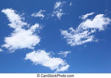 White fluffy clouds swim on beautiful blue sky