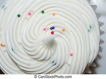 White fluffy frosting with colorful sprinkles - White ...