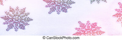 White fluffy snowflakes on snow. Winter christmas background.