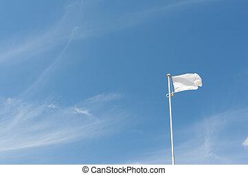 Blank white flying flag on a blue sky