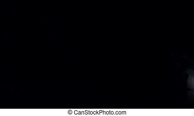 White fog swirls on isolated black studio background, slow motion