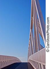 White footbridge on blue sky background