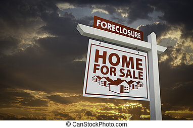 White Foreclosure Home For Sale Real Estate Sign Over Beautiful Clouds and Sunset Sky.