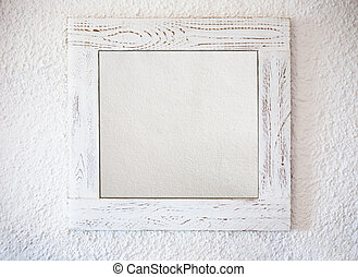 White frame with a paper on a white wall background