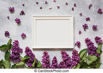 White frame for text with purple lilac. Top view.