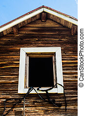 White Frame In An Old Log House