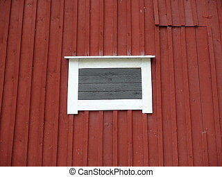 white frame on red wooden wall