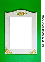 white frame on the green wall