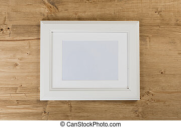 white frame on wooden background