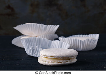 White french macaroons on rustic background