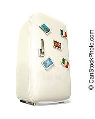 fridge - white fridge vith a colorful travel stickers.