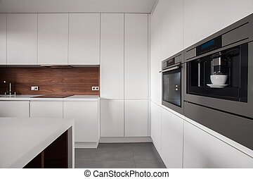 White furniture in wooden kitchen