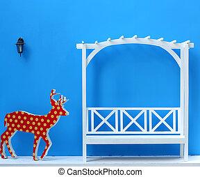White garden chair on blue background