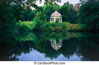 White Gazebo Rotunda By The Pond In The Park