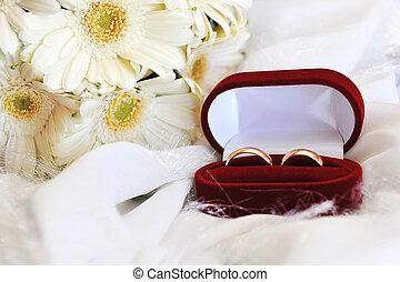 white gerbera and wedding rings