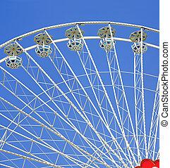 white ferries wheel with gondolas before blue sky