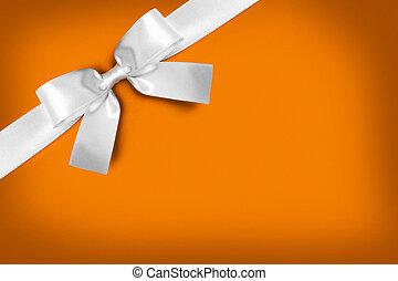 White gift bow on orange