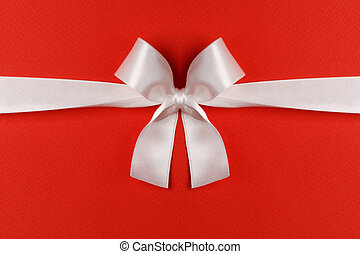 White gift bow on red