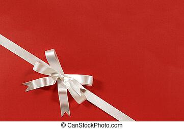 White gift bow ribbon red paper background corner diagonal