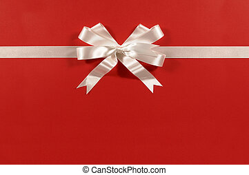 White gift bow ribbon red paper background straight horizontal