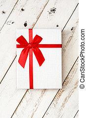 White gift box on white wooden background