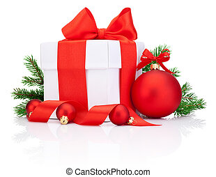 White gift box tied Red satin ribbon bow, Christmas ball and fir tree branch Isolated on white background