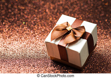 White gift box with brown bow on the background