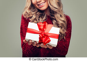 White Gift Box with Red Ribbon in Female Hand